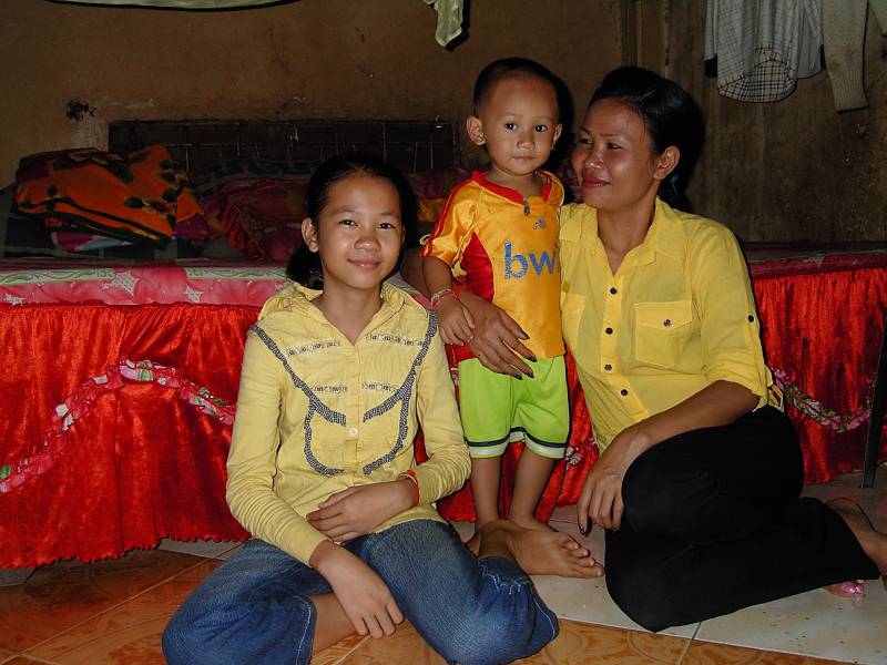 Srey Pov with her mom and brother at their home