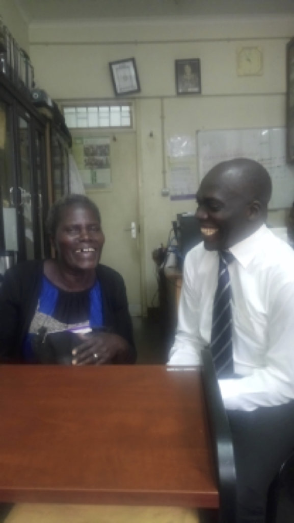 Toko in a light moment with a patient