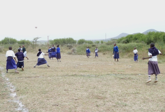 Older students enjoy a game of netball