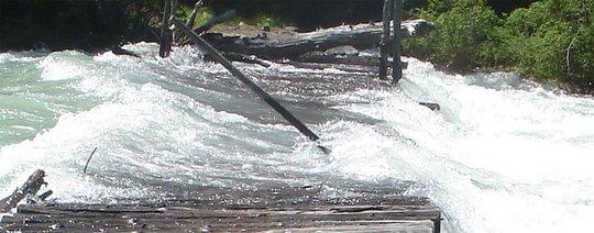 Flooded bridge in Altai Republic