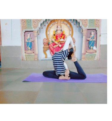 Student performing yoga