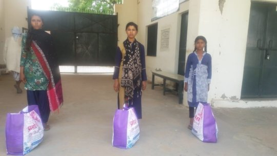 Students with their grocery bags