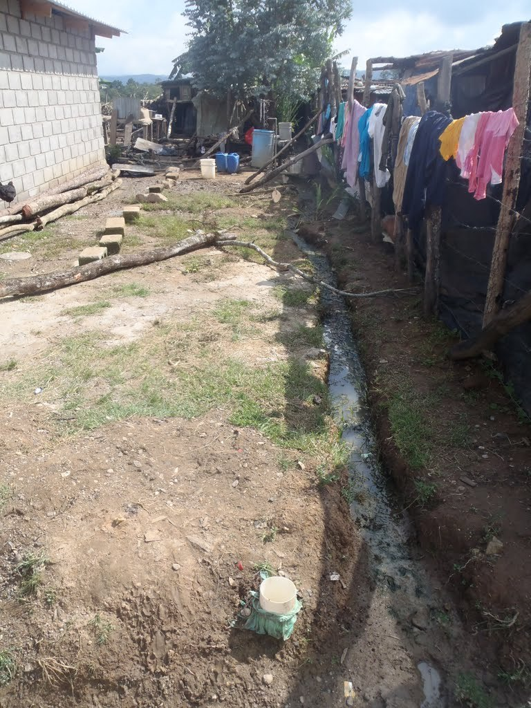 An improvised home drainage trench in Segovia.