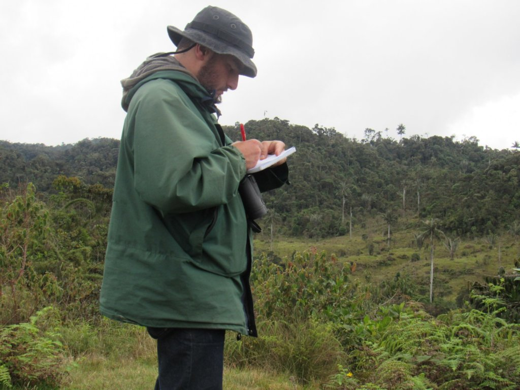 Forest guard Carlos Mario monitoring the parrots
