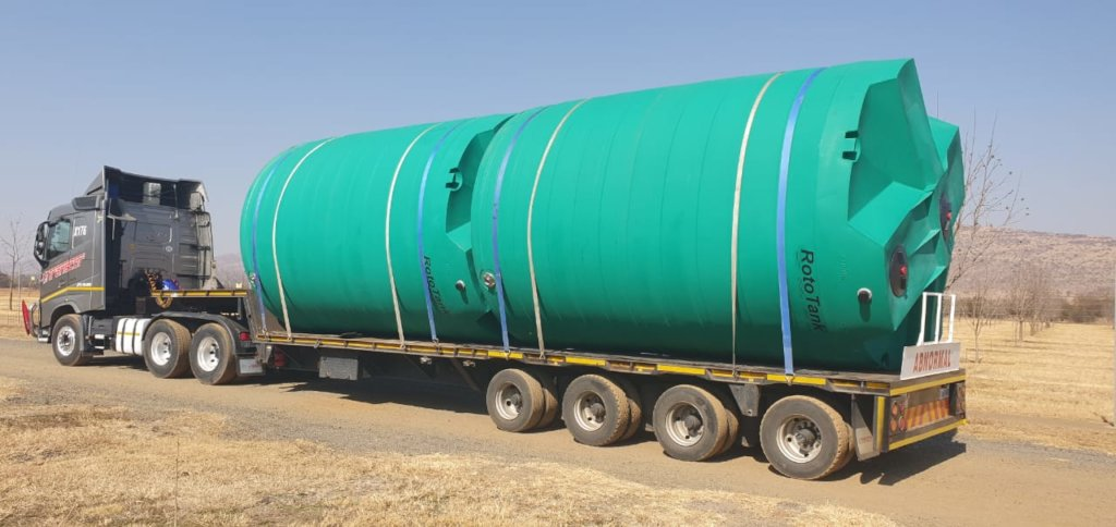 Water tanks in transport to Mwandi