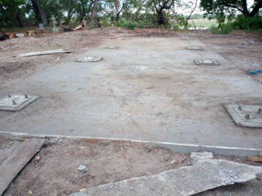 Finished base showing columns encased by slab
