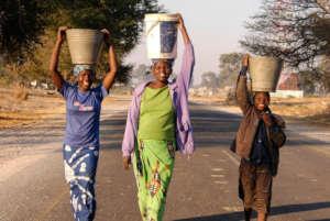 Women carrying water from Zambezi River