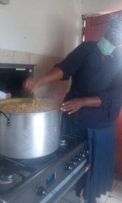 Nomfuneko cooking for her community