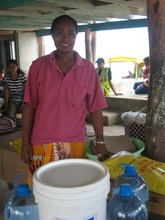 Fiataua Loto receiving aid