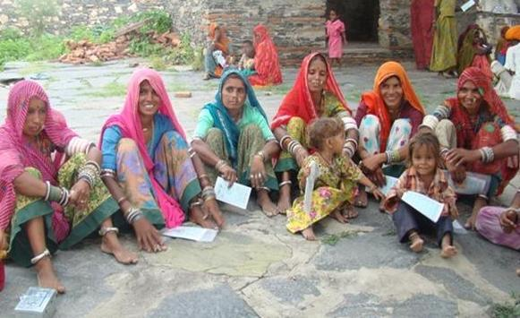 Women attending meeting in a village