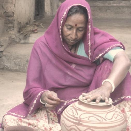 Rodi Bai making clay pots.