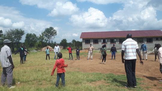 Tumaini staff conducting field life skills lessons