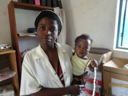 Health care worker with child holding CycleBeads