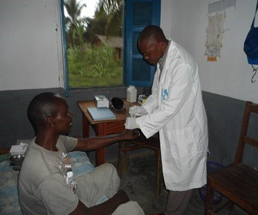 Innocent performing a test at Ndofia health center