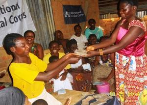VSLA member receiving her savings
