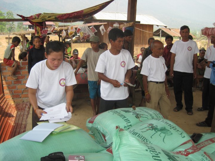 SEDA staff distributing rice and salt