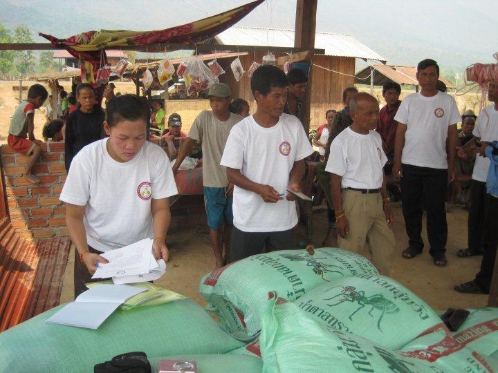 SEDA staff distributing rice and salt