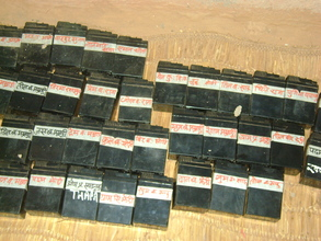 Batteries labeled with each household's name