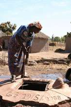 Villager draws water from a sanitized well