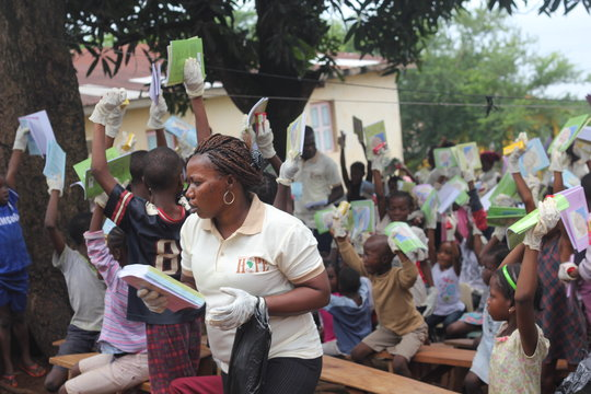 kids happy to receive exercise books