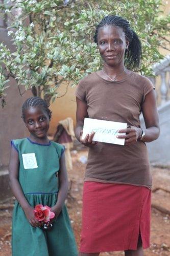 Fatmatta and her mother -scholarship recipient