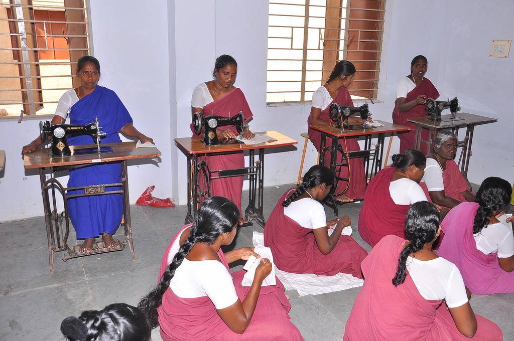 Women stitching their blouses