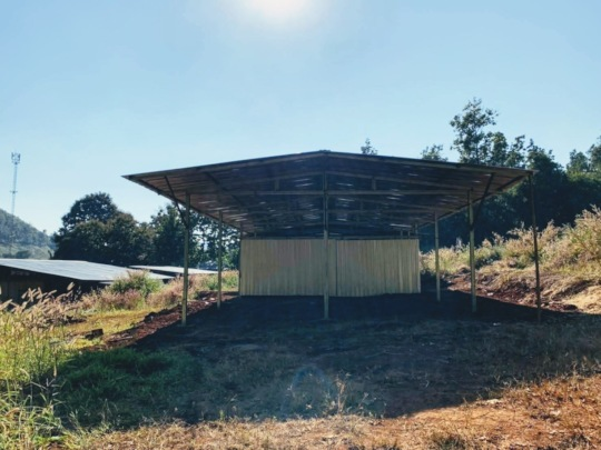 Biochar storage shed