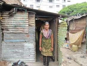 Renuka outside her house