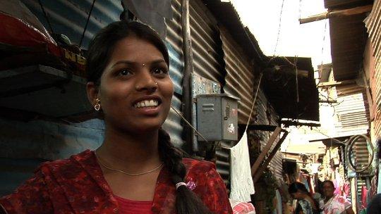 Kalpana outside her house