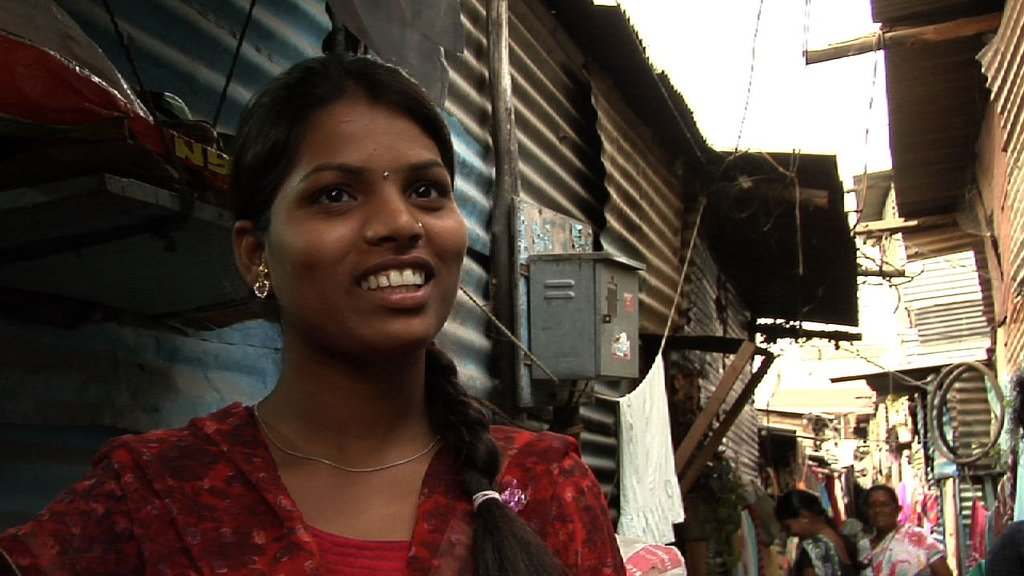 Kalpana outside her house