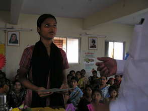 Priti receiving her computer skills certificate