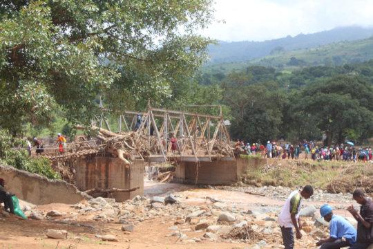 Zimbabweans crossing a makeshift bridge