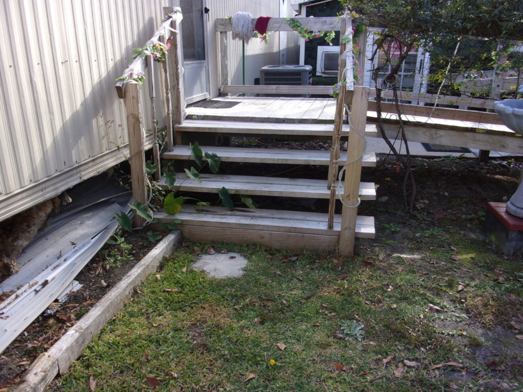 Ms. Barbara's porch before WARM rebuilt