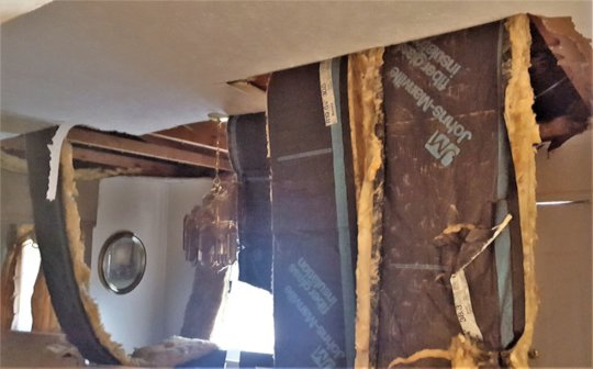 Photos of Dorothy's home with hurricane damage