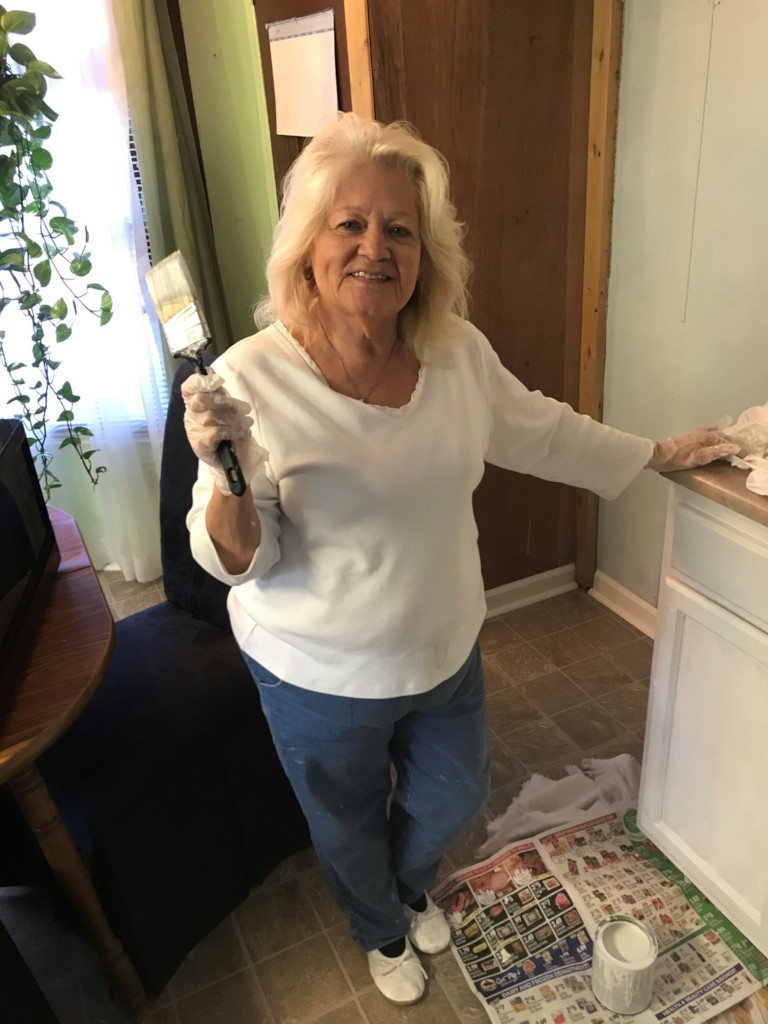 WARM homeowner Ms. Barbara helping WARM