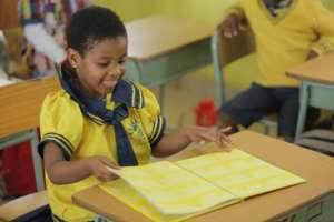 Child enjoying book in class