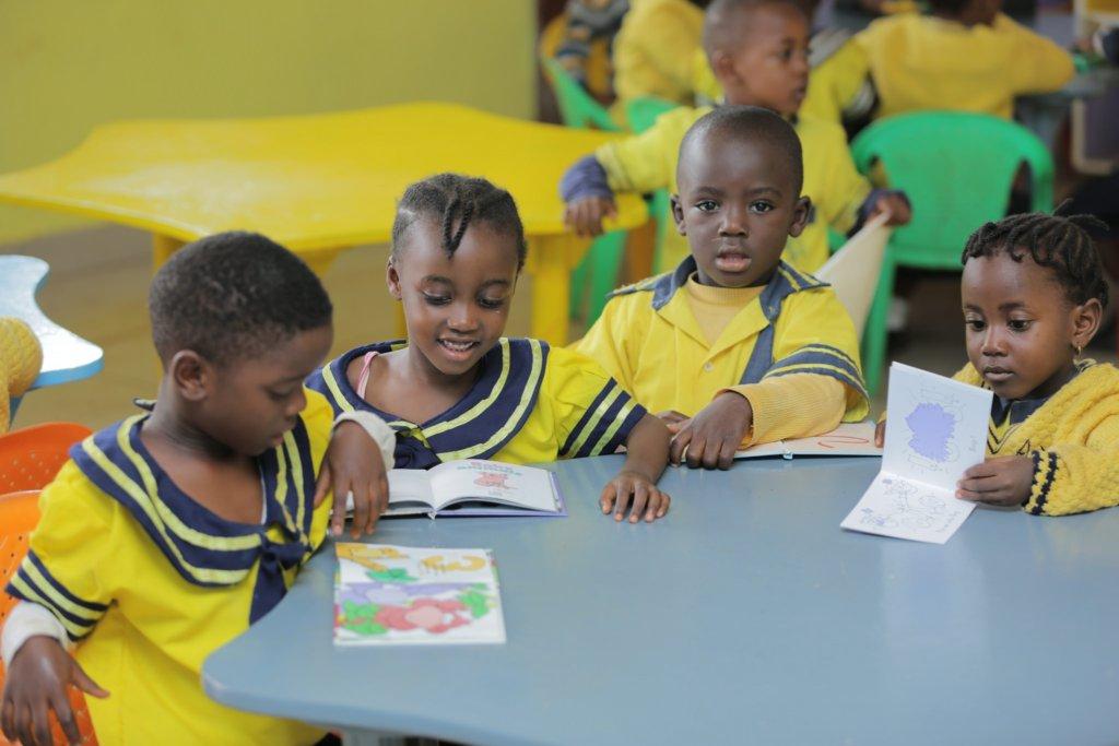 Children reading and enjoying their new books