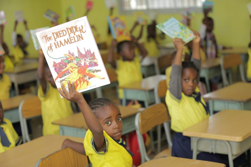 Kids in class displaying their new books