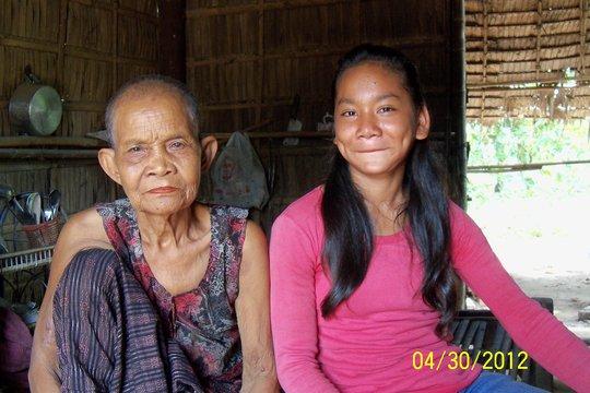 Kay & grandmother inside their house