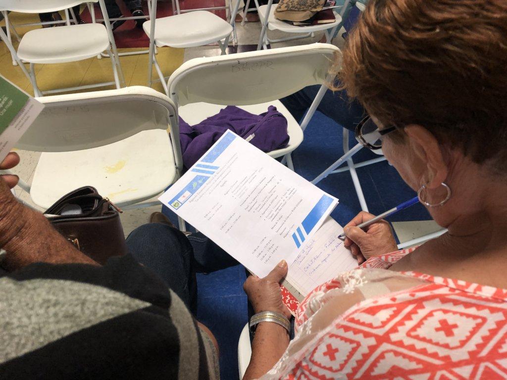 Woman reading the gathering agenda