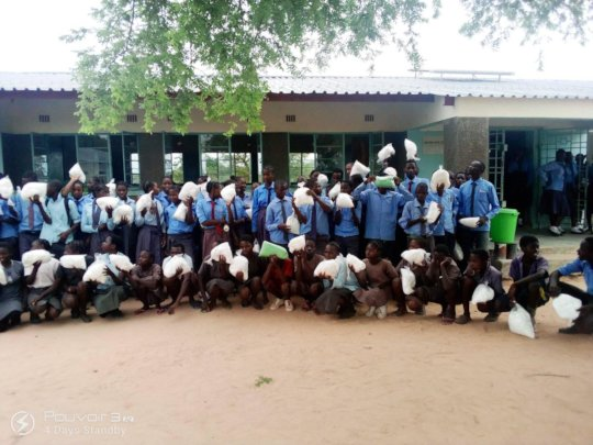 Mosquito net distribution - Malimba School
