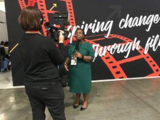Nozi Samela being interviewed