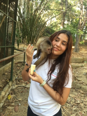 SAI Zoo Keeper Affectionately Feeds Adult Monkey
