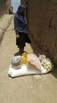 A student with 4 daughters receiving a food pack