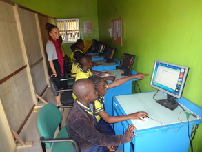 Children learning in computer room
