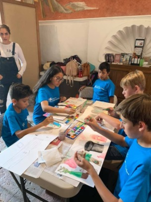 Making their own accordion-style sketchbooks