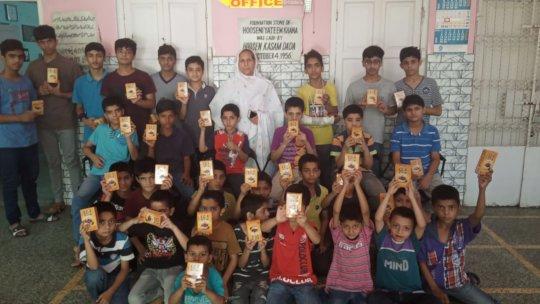 Orphans with their khajoor