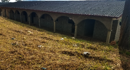 View of classroom block building with roof