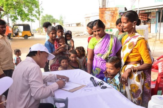 Mothers signing up their children for drops