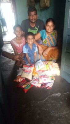 A family in New Delhi receiving food rations
